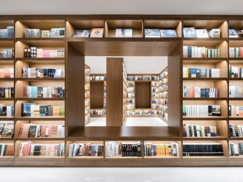 Wutopia inserts inverted triangular lightwell into book shop